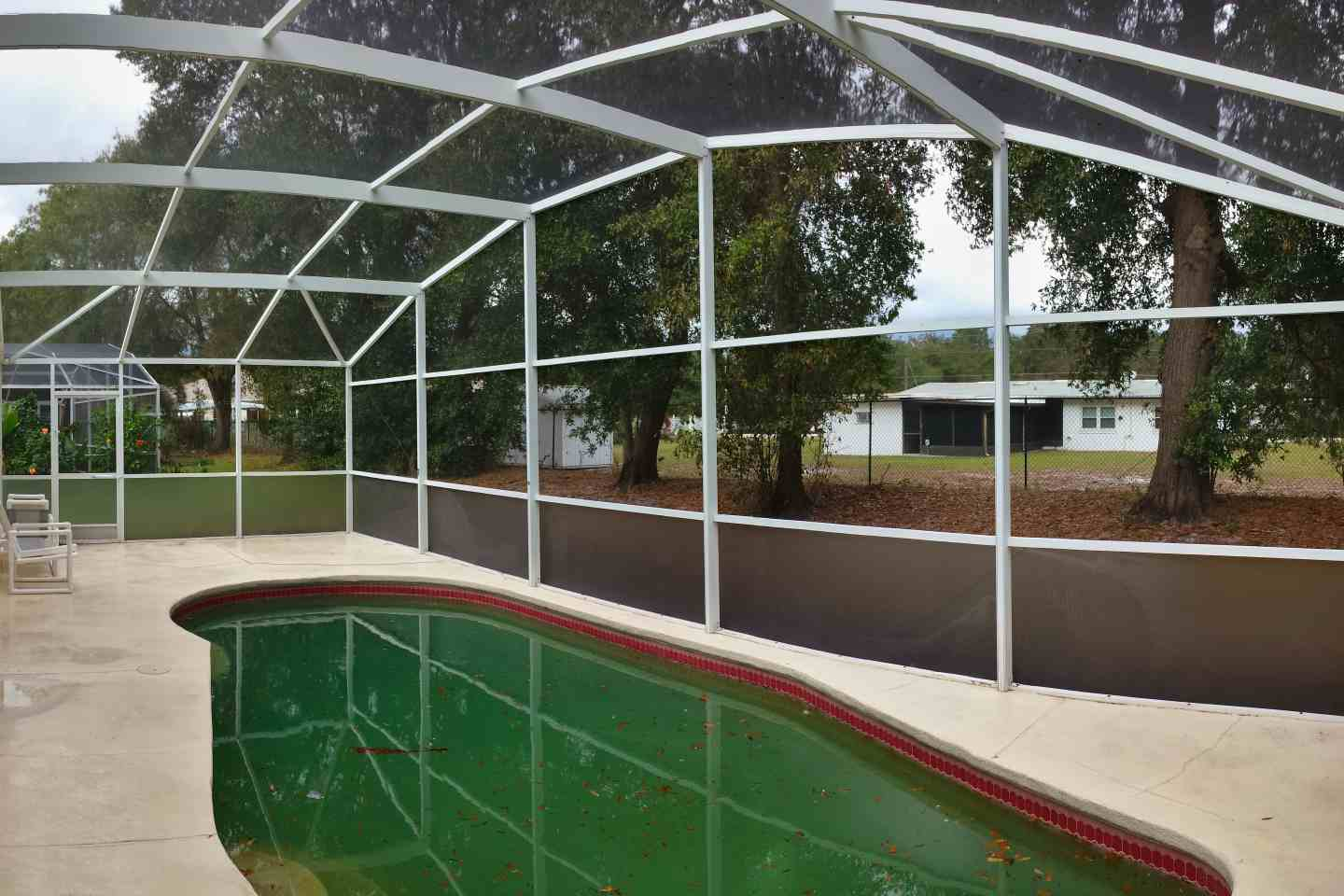 06-pool-enclosure-florida-glass-after-re-screen.jpg