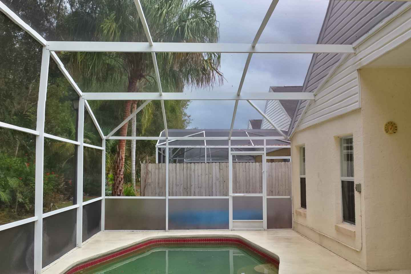 11-pool-enclosure-florida-glass-after-re-screen.jpg
